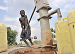 A boy obtains water for his family at a well installed by the United Methodist Committee on Relief (UMCOR) in Yei, a town in Central Equatoria State in Southern Sudan. NOTE: In July 2011, Southern Sudan became the independent country of South Sudan