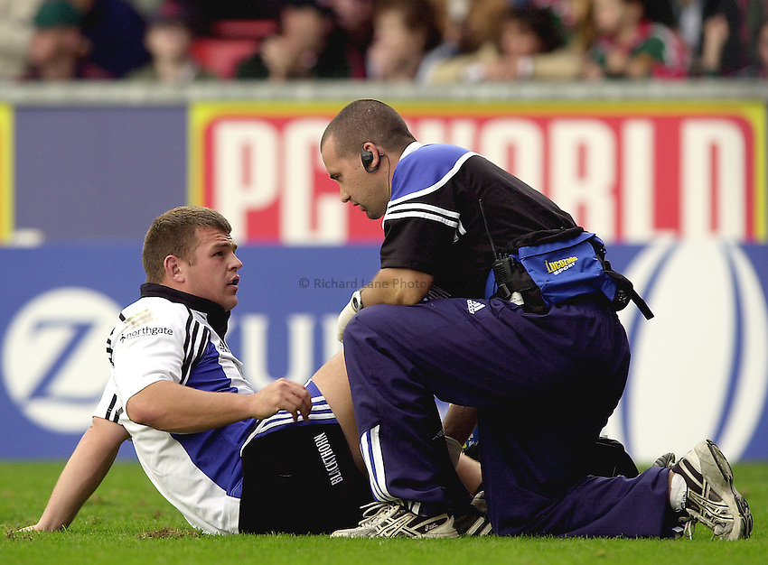 Photo. Richard Lane. .Leicester Tigers v Bath Rugby. Zurich Premiership. 05/10/2002.Lee Mears gets treatment.