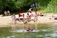 Clear, cool water and clean gravel beaches draw visitors to McKissic Creek's swimming hole in Bentonville. People swim all along the creek between U.S. 71 and Little Sugar Creek.<br />(NWA Democrat-Gazette/Flip Putthoff)