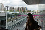 Visitors arrive Westfield Shopping Centre, Stratford City, East London  Uk Stratford International train station and Olympic village in distance.