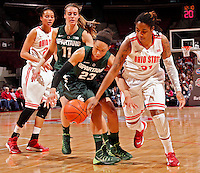 Ohio State Buckeyes guard Raven Ferguson (31) gets the ball stolen from her by Michigan State Spartans guard Aerial Powers (23) during the first half of their NCAA basketball game at Value City Arena in Columbus, Ohio on January 26, 2014.  (Dispatch photo by Kyle Robertson)