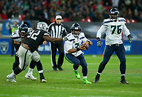 Seattle Seahawks Quarterback Russell Wilson (3) runs with the ball