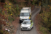 Pictured: Police a fire service vehicle at the entrance to the track leading to the house that burned in Llangammarch Wells, Powys, Wales, UK. Tuesday 31 October 2017<br />