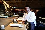 World-renowned Japanese chef Nobu Matsuhisa sits at the counter at his restaurant in central Tokyo, Japan. ROB GILHOOLY