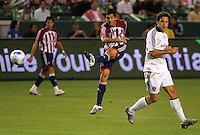 Chivas forward Ante Rozov (9) takes a shot on goal past LA Galaxy midfileder Kevin Harmse (6) . CD Chivas USA defeated the LA Galaxy 3-0 in the Super Classico MLS match at the Home Depot Center in Carson, California, Thursday, August 23, 2007.