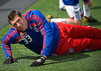 11 April 2009:  FC Dallas forward Kenny Cooper #33 does his stretching during the warm-up in an MLS game at BMO Field in Toronto between FC Dallas and Toronto FC. The game ended in a 1-1 draw.