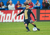 15 April 2010: Philadelphia Union midfielder Roger Torres #20 in action during a game between the Philadelphia Union and Toronto FC at BMO Field in Toronto..Toronto FC won 2-1..Photo by Nick Turchiaro/isiphotos.com.
