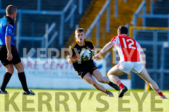 Gavin White Dr Crokes in action against Jason Hickson West Kerry in the Kerry Senior Football Championship Semi Final at Fitzgerald Stadium on Saturday.