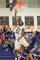 Cedar Ridge's Jerrod Smith jumps high for the basket Friday at Cedar Ridge Gym.  (LOURDES M SHOAF for Round Rock Leader.)
