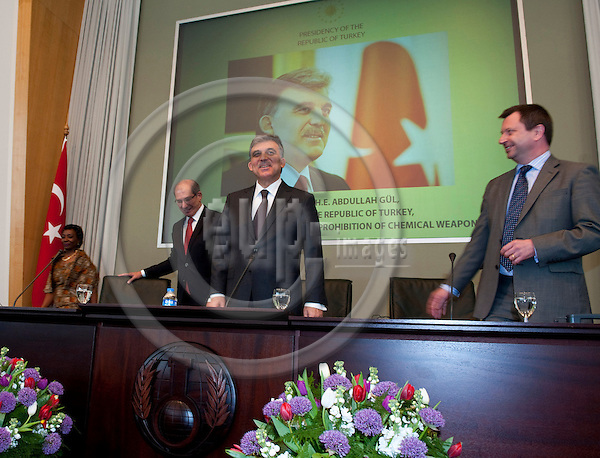 The Hague - The Netherlands, April 18, 2012 -- Ahmet ÜZÜMCÜ (Uezuemcue) (le), Director-General of OPCW (Organisation for the Prohibition of Chemical Weapons) with  Abdullah GÜL (Guel) (ce), President of Turkey, at OPCW Headquarters; with Ambassador Paul ARKWRIGHT (ri), Chair of the Conference of States Parties of OPCW -- Photo: Horst Wagner / eup-images