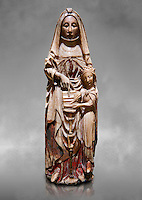 Gothic alabaster statue of Saint Anne and the Virgin Mary as a child from the Nottingham School England, 15th Century, from the cemetery of the vall de Bertizana, Nivarra.  National Museum of Catalan Art, Barcelona, Spain, inv no: MNAC  4353. Against a grey art background.