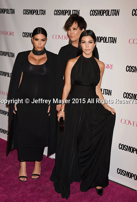 WEST HOLLYWOOD, CA - OCTOBER 12: (L-R) TV personalities Kim Kardashian, Kris Jenner and Kourtney Kardashian arrive at Cosmopolitan Magazine's 50th Birthday Celebration at Ysabel on October 12, 2015 in West Hollywood, California.