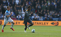 Leicester City's Demarai Gray tracked by Huddersfield Town's Jonathan Hogg <br /> <br /> Photographer Stephen White/CameraSport<br /> <br /> The Premier League - Huddersfield Town v Leicester City - Saturday 6th April 2019 - John Smith's Stadium - Huddersfield<br /> <br /> World Copyright © 2019 CameraSport. All rights reserved. 43 Linden Ave. Countesthorpe. Leicester. England. LE8 5PG - Tel: +44 (0) 116 277 4147 - admin@camerasport.com - www.camerasport.com