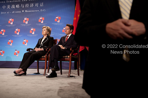 Washington, DC - July 27, 2009 -- United States Secretary of State Hillary Clinton and U.S. Secretary of the Treasury Timothy Geithner look on as President Barack Obama addresses the opening session of the first U.S.-China Strategic and Economic Dialogue at the Ronald Reagan Building and International Trade Center in Washington on Monday, July 27, 2009.  .Mandatory Credit: Pete Souza - White House via CNP