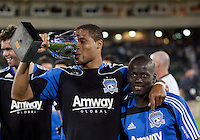 """Ryan Johnson """"drinks"""" from the Sacramento Cup. The San Jose Earthquakes defeated Chivas USA 6-5 in shootout after drawing 0-0 in regulation time to win the inagural Sacramento Cup at Raley Field in Sacramento, California on June 12, 2010."""