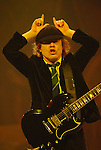 AC/DC guitarist Angus Young flashes his famous devil horns during the band's stop at the Toyota Center Sunday Dec. 14, 2008. (Dave Rossman for the Chronicle)