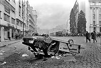 ROMANIA, Str. Academiei, Bucharest, 23.12.1989<br /> People rise against Ceausescu. The dictator has fled the city on dec. 22. Burnt Dacia car.<br /> © Andrei Pandele / EST&OST