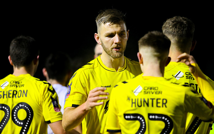 Fleetwood Town's Ashley Eastham celebrates with teammates after the match<br /> <br /> Photographer Alex Dodd/CameraSport<br /> <br /> The Emirates FA Cup Second Round - Guiseley v Fleetwood Town - Monday 3rd December 2018 - Nethermoor Park - Guiseley<br />  <br /> World Copyright &copy; 2018 CameraSport. All rights reserved. 43 Linden Ave. Countesthorpe. Leicester. England. LE8 5PG - Tel: +44 (0) 116 277 4147 - admin@camerasport.com - www.camerasport.com