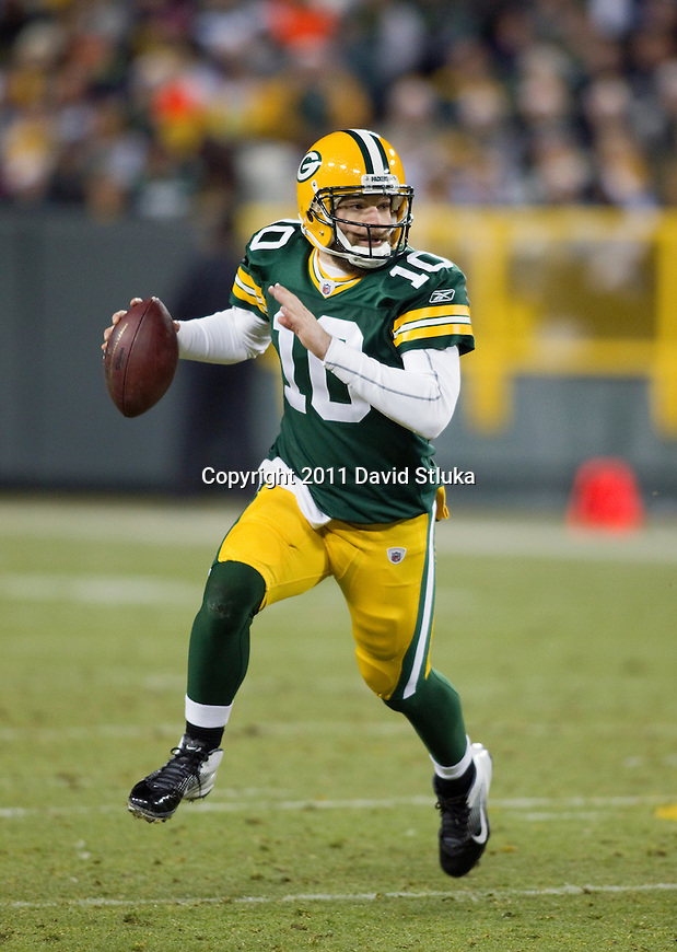 Green Bay Packers backup quarterback Matt Flynn (10) scrambles during a week 16 NFL football game against the Chicago Bears on December 25, 2011 in Green Bay, Wisconsin. The Packers won 35-21. (AP Photo/David Stluka)