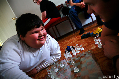 Dzhambulat Khotokhov, 6, one of the fattest boys in the world, plays chesse with a British journalist at his home in Terek, in southern Russia. Now 1.4 metres tall and weighing about 100 kg, Khotokhov has grabbed world attention as the biggest kid in the world since he was three. .Khotokhov lives with his mother Neyla and his brother, 14-year-old Mukha. .