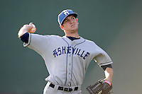 Starting pitcher Konner Wade (11) of the Asheville Tourists warms up before a game against the Greenville Drive on Monday, April 21, 2014, at Fluor Field at the West End in Greenville, South Carolina. Greenville won, 8-3. (Tom Priddy/Four Seam Images)