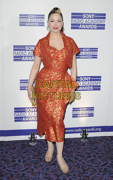 IMELDA MAY.The Sony Radio Academy Awards 2011, Grosvenor House Hotel, Park Lane, London, England..May 9th, 2011.full length gold orange red print peplum wrap cropped jacket clutch bag peep toe shoes .CAP/CAN.©Can Nguyen/Capital Pictures.