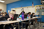 November 15, 2011. Mooresville, NC.. Collin Walsh, a student at East Mooresville Intermediate School, works on his school issued laptop on a 5th grade science lesson. Many of the in-class lessons are done on school issued laptops and turned in to the teacher via networked printer.. The Mooresville school system has become nationally known for being on the cutting edge of using technology as an educational tool. Starting in 3rd grade, each student is issued their own laptop that they will use in class and at home to further their learning.