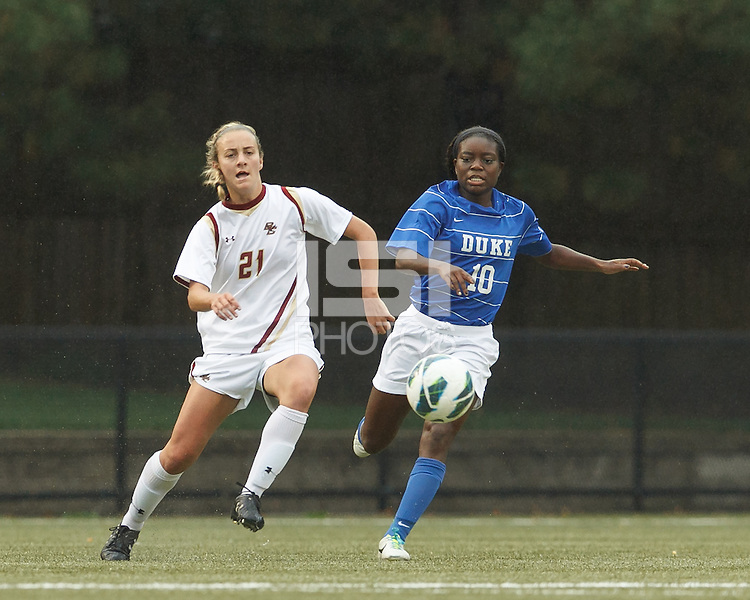 Boston College midfielder Kate McCarthy (21) controls the ball as Duke University midfielder Toni Payne (10) closes.Boston College (white) defeated Duke University (blue/white), 4-1, at Newton Campus Field, on October 6, 2013.