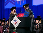 Darsie Bowden, professor of writing, rhetoric and discourse, receives a Via Sapientiae Award Sunday, June 11, 2017, from Marten denBoer, provost, during the DePaul University College of Science and Health and College of Liberal Arts and Social Sciences commencement ceremony at the Allstate Arena in Rosemont, IL. (DePaul University/Jamie Moncrief)