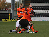 Gavin Gunning and Lee Mair tangle in the St Mirren v Dundee United Clydesdale Bank Scottish Premier League match played at St Mirren Park, Paisley on 27.10.12.
