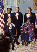"The recipients of the 16th Annual Kennedy Center Honors pose for a group photo following a dinner at the United States Department of State in Washington, D.C. on Saturday, December 4, 1993.  Back row, from left to right: Arthur Mitchell, founder of the Dance Theatre of Harlem; former ""Tonight Show"" host Johnny Carson; and composer and lyricist Stephen Sondheim. Front row, from left to right: conductor Georg Solti and gospel singer Marion Williams.  The 1993 honorees are: Johnny Carson, Arthur Mitchell, Georg Solti Stephen Sondheim and Marion Williams.<br /> Credit: Greg E. Mathieson / Pool via CNP"