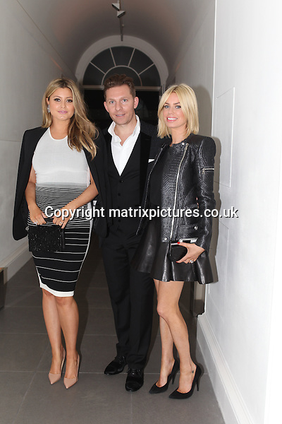 NON EXCLUSIVE PICTURE: TREVOR ADAMS / MATRIXPICTURES.CO.UK<br /> PLEASE CREDIT ALL USES<br /> <br /> WORLD RIGHTS<br /> <br /> British luxury property developer Nick Candy, his pregnant wife, Australian singer Holly Valance and Caroline Stanbury attending the CANDY Magazine Autumn/Winter 2013 Launch Party, hosted by Nick Candy at the Saatchi Gallery in King's Road, London.<br /> <br /> OCTOBER 15th 2013<br /> <br /> REF: MTX 136759