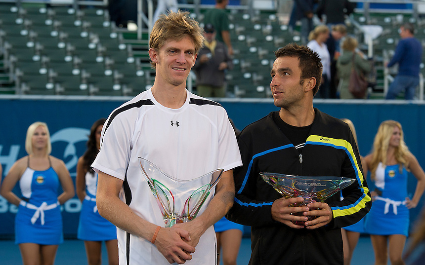 Kevin Anderson (RSA) (L) poses with the trophy after his victory over Marinko Matosevic (AUS)  in their Final match today - Kevin Anderson (RSA) def Marinko Matosevic (AUS) 7-5 7-6(4)..ATP 250 Tennis - 2012 Delray Beach International Tennis Championships - Day 7 - Sunday 04 March 2012 - Delray Beach Stadium & Tennis Center - Delray Beach - Florida - USA..