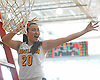 Adelphi University No. 20 Anh-Dao Tran cuts off a ceremonial piece of the net after her team's 79-57 win over American International College in the Northeast-10 women's basketball championship at Adelphi's Center for Recreation and Sport on Sunday, March 8, 2015. She scored all of her game-high 20 points in the second half as the victory secured the Panthers an automatic bid to the NCAA Division II tournament.<br /> <br /> James Escher