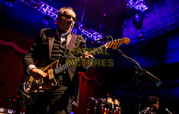 LAS VEGAS, NV - March 16 : Elvis Costello with The Roots performs for Grand Opening weekend at The Brooklyn Bowl Las Vegas in Las Vegas in Las Vegas, NV on March 16, 2014. <br /> CAP/MPI/RTNRDKabik<br /> &copy;RTNRDKabik/MediaPunch/Capital Pictures