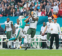 04.10.2015. Wembley Stadium, London, England. NFL International Series. Miami Dolphins versus New York Jets. New York Jets Wide Receiver Brandon Marshall about to catch the ball but Miami Dolphins Cornerback Brent Grimes causes a fumble.