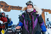Jessie Royer poses at the Nome finish line shortly after placing 3rd in the 2019 Iditarod sled dog race.<br /> <br /> Photo by Jeff Schultz/  (C) 2019  ALL RIGHTS RESERVED