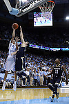 05 January 2015: North Carolina's Justin Jackson (44) shoots over Notre Dame's Pat Connaughton (24) and Demetrius Jackson (11). The University of North Carolina Tar Heels played the University of Notre Dame Fighting Irish in an NCAA Division I Men's basketball game at the Dean E. Smith Center in Chapel Hill, North Carolina. Notre Dame won the game 71-70.