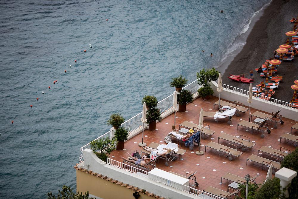 Tourists enjoy the sun on a balcony overlooking the Tyrrhenian Sea on Sunday, Sept. 20, 2015, in Positano, Italy. (Photo by James Brosher)