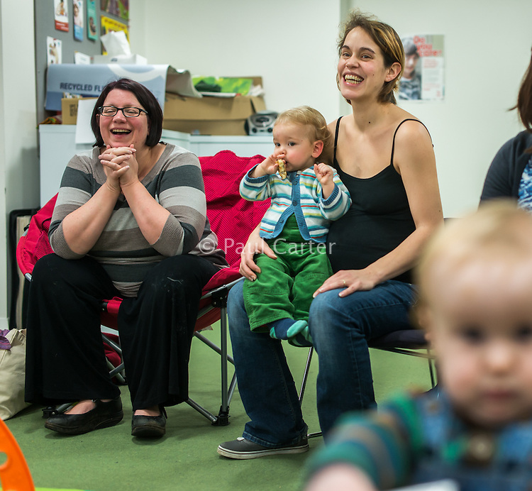 Mothers at a drop-in breastfeeding support centre.Image from the &quot;We Do It In Public&quot; documentary photography picture library project: <br />  www.breastfeedinginpublic.co.uk<br /> <br /> Hampshire, England, UK<br /> 29/01/2014<br /> <br /> &copy; Paul Carter / wdiip.co.uk