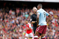 Referee, Jonathan Moss and Wesley of Aston Villa during the Premier League match between Arsenal and Aston Villa at the Emirates Stadium, London, England on 22 September 2019. Photo by Carlton Myrie / PRiME Media Images.