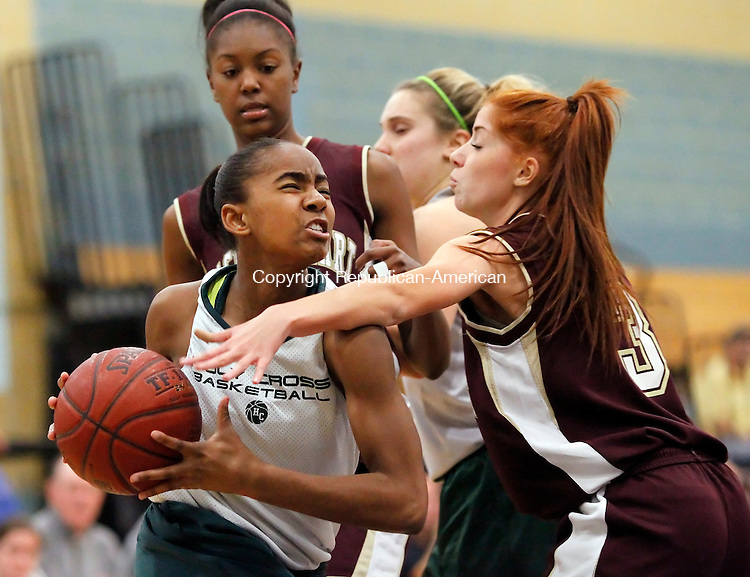 Waterbury, CT-03 December 2011-120311CM07- Holy Cross' Briana Bradford charges to the hoop as Sacred Heart's Elena Colaci gets called for the foul during the City Jamboree at Kennedy High School in Waterbury Saturday afternoon.  Holy Cross won the event after defeating Wilby 19-8.   Christopher Massa Republican-American