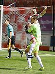 Mikey Devlin celebrates with hero keeper Remi Matthews after winning penalty shootout