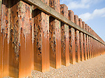 Rusty steel piling sea wall defences and shingle beach near Bawdsey Quay, Suffolk, England