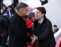 Pictured L-R: West Ham manager Sam Allardyce greets Swansea manager Michael Laudrup. 01 February 2014<br />