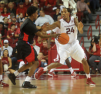 NWA Media/Michael Woods --11/21/2014-- w @NWAMICHAELW...University of Arkansas forward Michael Qualls puts the pressure on Delaware States Kendal Williams as he tries to bring the ball up court during the second half of Friday nights game  against Delaware State at Bud Walton Arena in Fayetteville.
