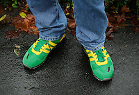 A Norwich City fan with team coloured Adidas trainers during the Barclays Premier League match between Norwich City and Swansea City played at Carrow Road, Norwich on November 6th 2015