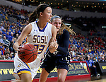 SIOUX FALLS, SD: MARCH 5: Sydney Tracy #33 from South Dakota State University gets a step past Rachel Skalnik #13 from Oral Roberts during the Summit League Basketball Championship on March 5, 2017 at the Denny Sanford Premier Center in Sioux Falls, SD. (Photo by Dave Eggen/Inertia)