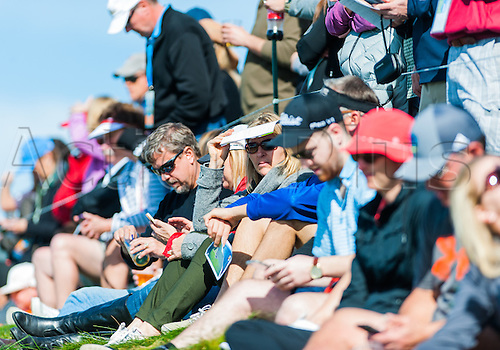 14.02.2016. Carmel, California, USA.  Spectators watch as golfers tee off from the 7th hole at Pebble Beach Golf Links  during the final  round of the AT&T Pebble Beach National Pro-Am  in Pebble Beach, CA.