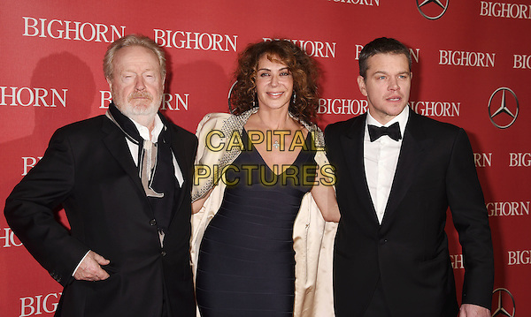 PALM SPRINGS, CA - JANUARY 02: (L-R) Director Ridley Scott, actress Giannina Facio-Scottand actor Matt Damon attend the 27th Annual Palm Springs International Film Festival Awards Gala at Palm Springs Convention Center on January 2, 2016 in Palm Springs, California.<br /> CAP/ROT/TM<br /> &copy;TM/ROT/Capital Pictures